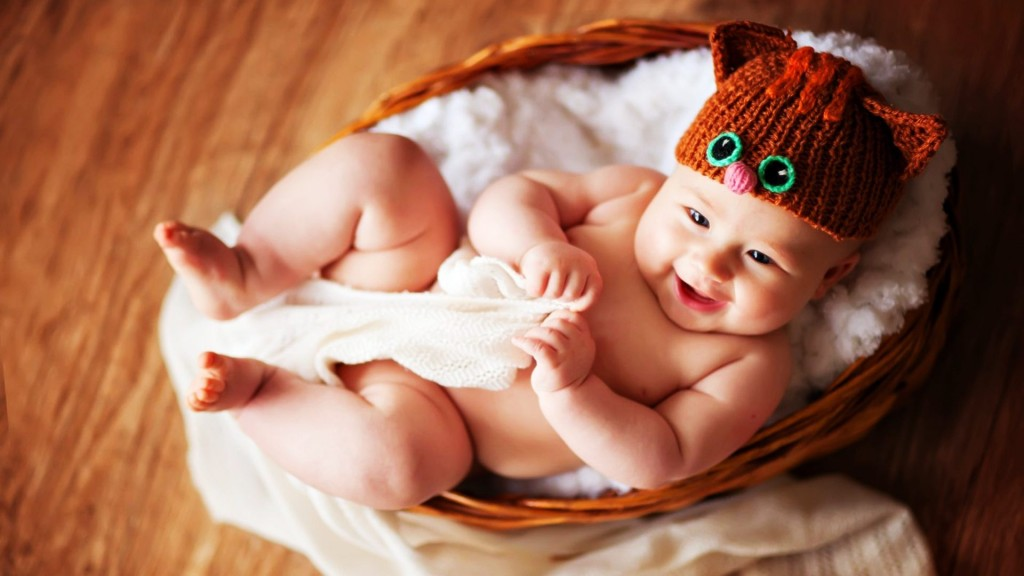 Smiling-face-of-cute-baby-in-basket